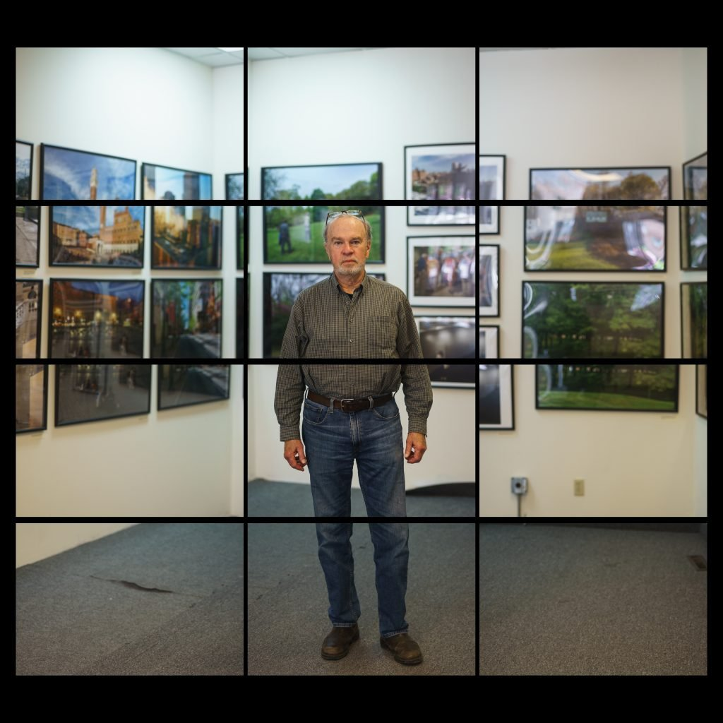 white male in a photography gallery