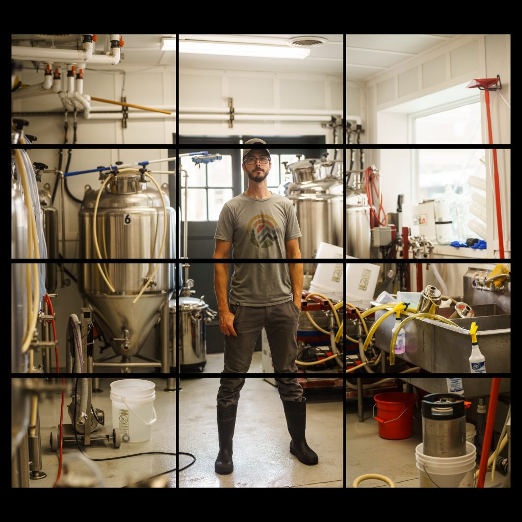 white male in a room with stainless steel vats and sinks