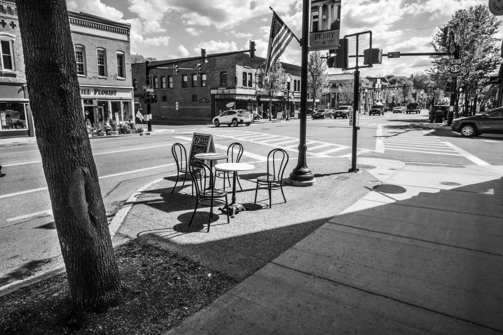 small café tables and chairs on sidewalk