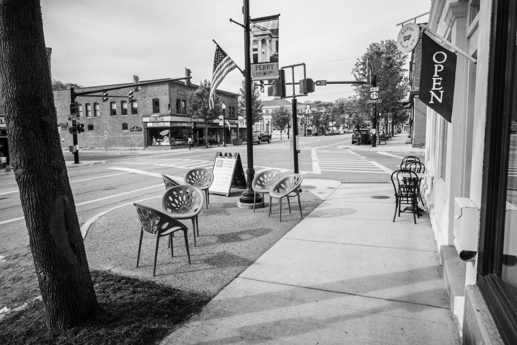 chairs on a street corner