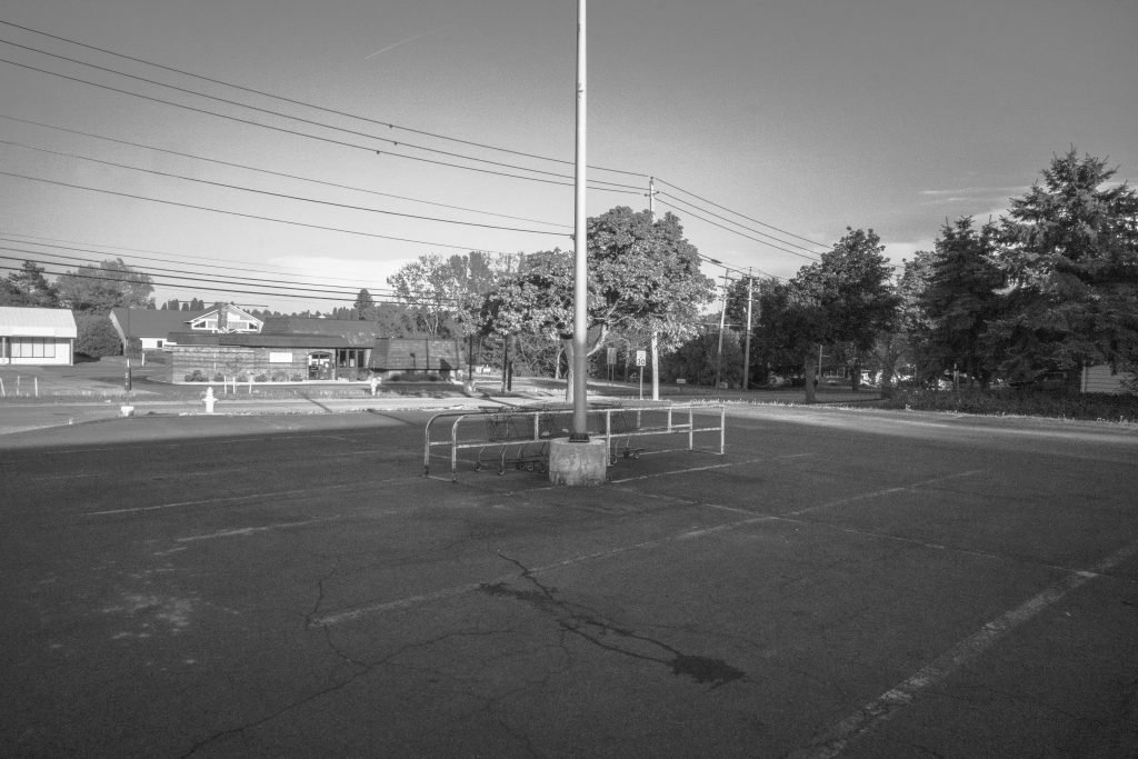 empty parking lot with lamp post